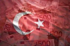 Kolorowego falowania turecka flaga na euro tle Fotografia Stock
