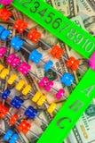 Kolorowi abakusa i amerykanina dolary, tło tekstura Obraz Royalty Free