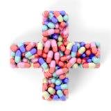 Kolorowi caplets w kształcie medyczny krzyż ilustracji