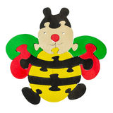Kolorowi drewniani łamigłówka kawałki w pszczoła kształcie Obraz Stock