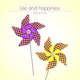 Kolorowi fiołkowi i żółci pinwheels Obrazy Stock