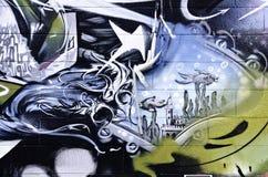 Kolorowi graffiti na textured ściana z cegieł Fotografia Royalty Free