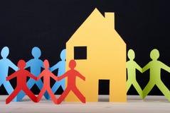 Kolorowi ludzie i dom Obraz Stock