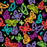 Kolorowi motyle w rocznika stylu latają na czarnym backgroun Fotografia Stock