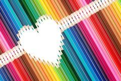 Kolorowi ołówki ustawiający w środku kierowy kształt Zdjęcie Royalty Free