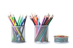Kolorowi ołówki w właścicielu Zdjęcie Royalty Free