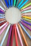 Kolorowi ołówki na bambus desce Zdjęcia Stock