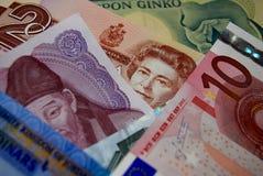 Kolorowi obca waluta banknotów rachunki Zdjęcia Royalty Free
