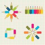 Kolorowi ołówki na notatnika tle Zdjęcie Royalty Free