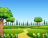 Kolorowi Wielkanocni jajka na zielonej trawie z pięknym krajobrazem royalty ilustracja