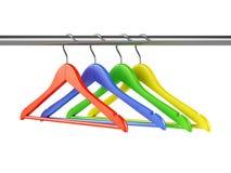 Kolorowi wieszaki na ubrania poręczu Zdjęcie Royalty Free