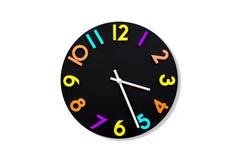 Kolorowy ścienny zegar na białym tle obrazy stock
