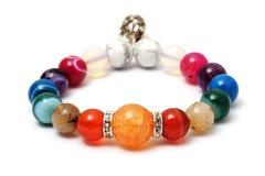 Kolorowy agat, jaspisowa bransoletka dekoruje z srebnym korona breloczkiem Obrazy Royalty Free