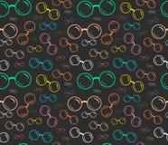 Kolorowy bezszwowy eyeglasses wzór na ciemnym tle Obraz Stock