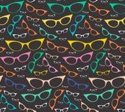 Kolorowy bezszwowy eyeglasses wzór na ciemnym tle Fotografia Royalty Free