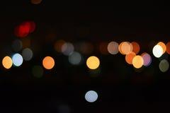 Kolorowy bokeh światło przy nocą jako tło Obraz Royalty Free