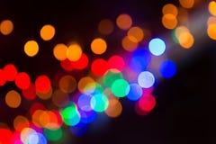 Kolorowy bokeh na ciemnym tle Defocused bokeh lignts Abstrakcjonistyczny Bożenarodzeniowy batskground Abstrakcjonistyczny kółkowy Fotografia Stock