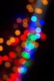 Kolorowy bokeh na ciemnym tle Defocused bokeh lignts Abstrakcjonistyczny Bożenarodzeniowy batskground Abstrakcjonistyczny kółkowy Fotografia Royalty Free