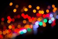 Kolorowy bokeh na ciemnym tle Defocused bokeh lignts Abstrakcjonistyczny Bożenarodzeniowy batskground Abstrakcjonistyczny kółkowy Zdjęcie Royalty Free