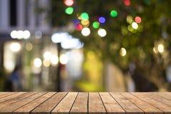 Kolorowy bokeh na drewnianym zamazanym tle Obraz Stock