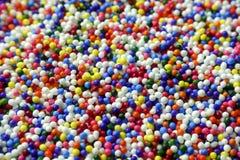 Kolorowy cukier kropi tortowych wystroje Zdjęcie Royalty Free