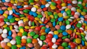 Kolorowy czekoladowy cukierek wiruje tło zdjęcie wideo