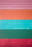 Kolorowy drewniany ścienny tło Fotografia Stock