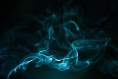 Kolorowy dym na ciemnym tle Obrazy Royalty Free