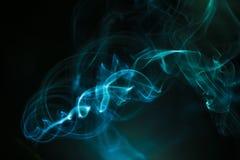Kolorowy dym na ciemnym tle Zdjęcie Royalty Free