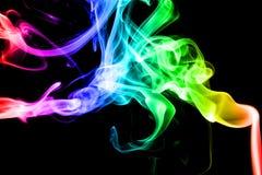 Kolorowy dym na czarnym tle, Fotografia Royalty Free