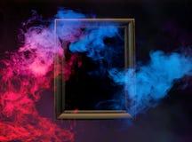Kolorowy dym od drewnianej ramy Zdjęcia Royalty Free