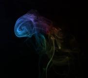 Kolorowy dym w ciekawym kształta czerni tle Zdjęcia Stock