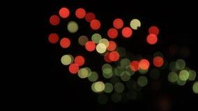 Kolorowy fajerwerku bokeh zaświeca przy nocne niebo wakacje tłem zbiory wideo