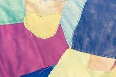Kolorowy kołdrowy tkaniny tło Zdjęcia Stock