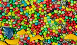 Kolorowy kolaż różnorodny cukierków i cukierków widok od above zdjęcie stock