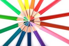 Kolorowy koloru ołówek układał w przekątny linii na białym tle Obrazy Royalty Free