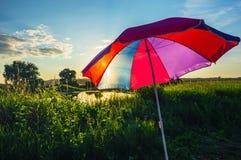 Kolorowy parasol w lecie przy zmierzchem Obrazy Stock