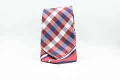 Kolorowy pasiasty i w kratkę jedwabniczy mężczyzna krawat odizolowywający na białym tle Fotografia Royalty Free