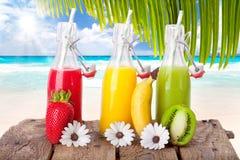 Kolorowy sok przy plażą Obrazy Royalty Free