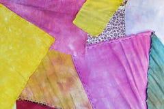 Kolorowy tkaniny kołderki tło Zdjęcie Stock