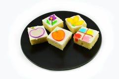Kolorowy tort na talerzu Obraz Stock