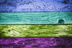 Kolorowy zabarwiający wietrzejący drewnianych desek tło Obrazy Royalty Free