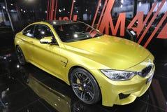 Koloru żółtego bmw m4 sportowy samochód Zdjęcie Stock