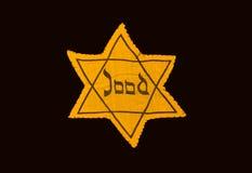 Koloru żółtego i czerni gwiazda który być ubranym w Oc wymagali żyd obraz royalty free