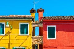 Koloru żółtego i czerwieni domy Fotografia Stock