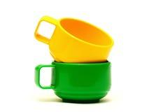 Koloru żółtego i zieleni filiżanki Fotografia Royalty Free
