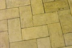 Koloru żółtego kamienny podłogowy tło obrazy royalty free