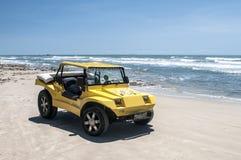 Koloru żółtego plażowy powozik Obrazy Stock