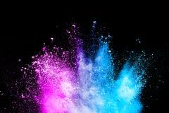 Koloru prochowy wybuch na czarnym tle fotografia stock