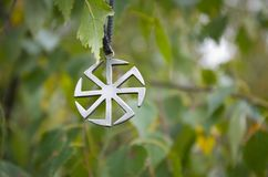 Kolovrat - Slavic pagan symbol. Stock Photo
